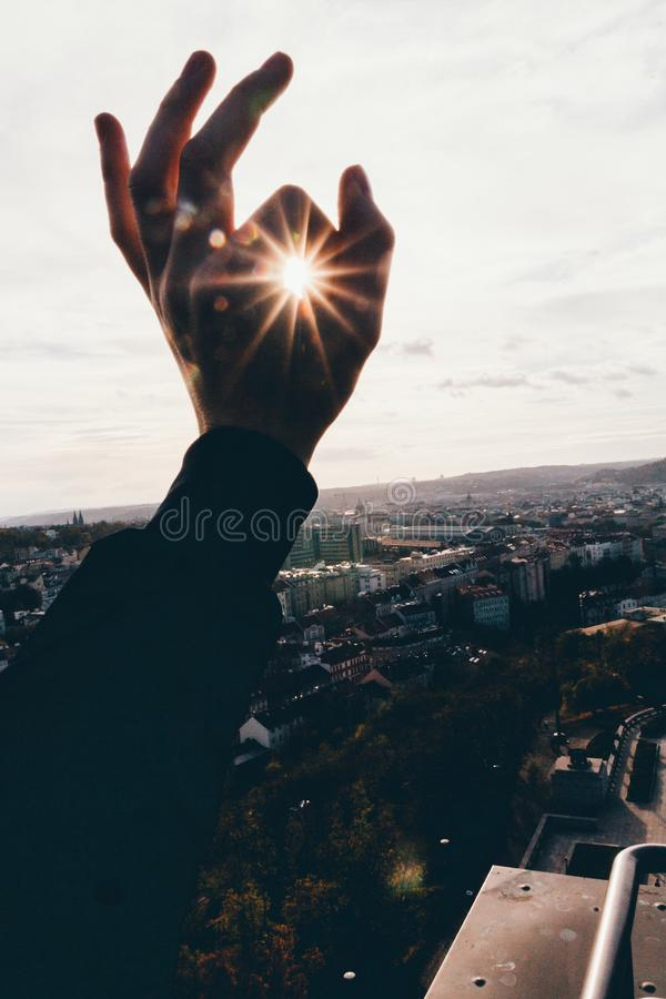 holding sun stock photos