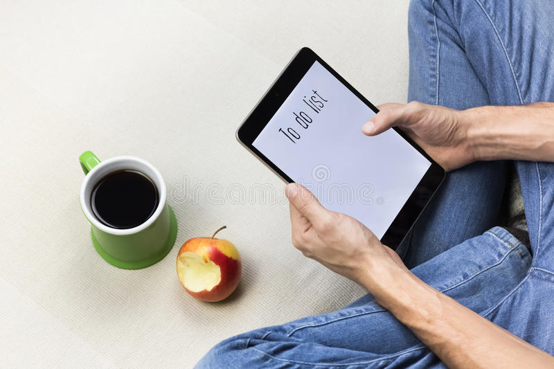 Holding tablet PC royalty free stock image