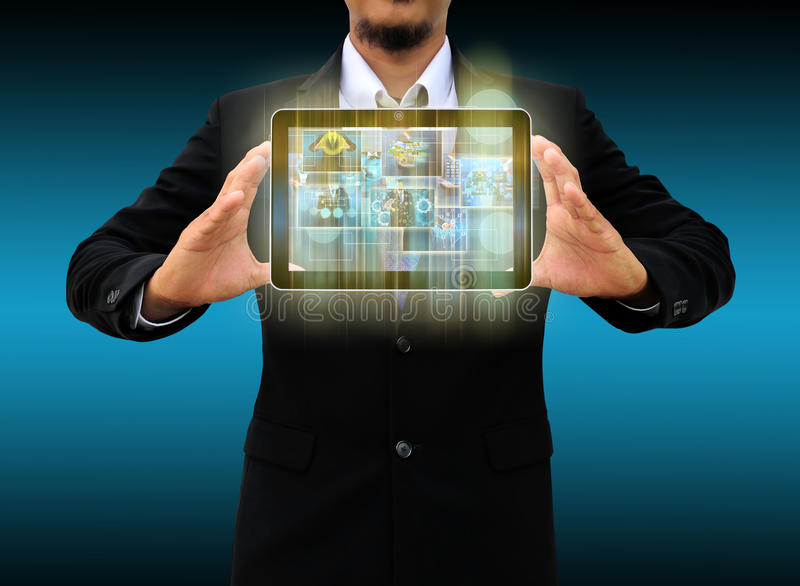 Holding tablet world technology and social media. Businessman holding tablet world technology and social media royalty free stock images