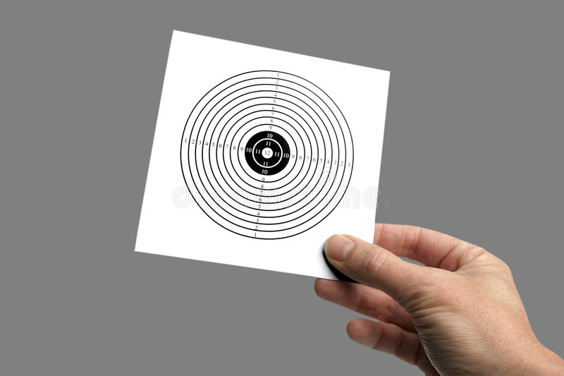 Holding a target. Hand holding a target on grey background, get your targets, or reach your goals,please take a look at my other images of targets royalty free stock image