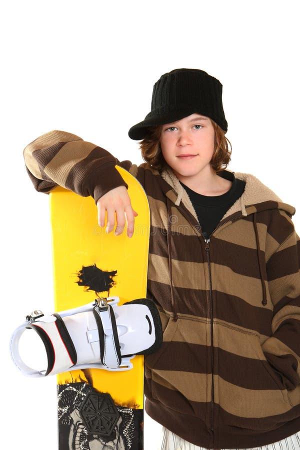 Holding teenager uno snowboard fotografia stock libera da diritti
