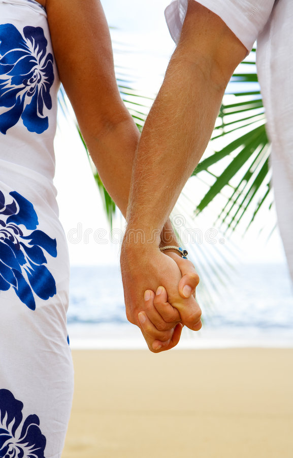 Holding tight. View of man's and woman's hands holding together tight stock photos