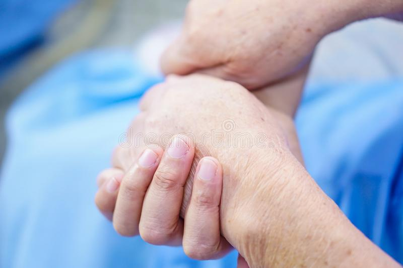 Holding Touching hands Asian senior or elderly old lady woman patient with love, care, helping, encourage and empathy. Holding Touching hands Asian senior or stock photos