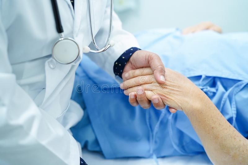 Holding hand Asian senior or elderly old lady patient with love, care, encourage and empathy. Holding Touching hands Asian senior or elderly old lady woman stock image