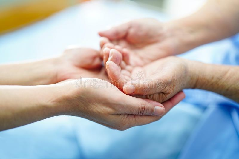Holding Touching hands Asian senior or elderly old lady woman patient with love, care, helping, encourage and empathy at nursing h royalty free stock photography