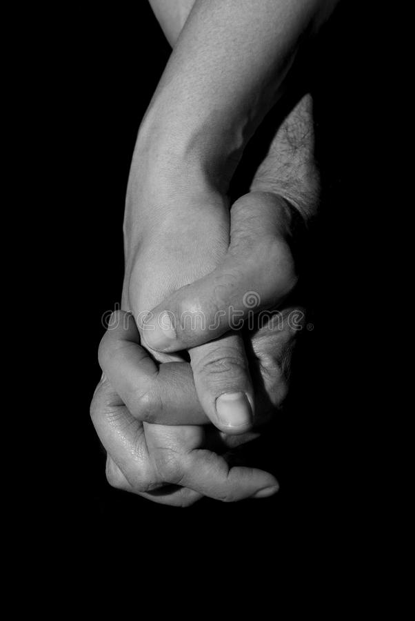 Holding two hands together. Union and love concept. royalty free stock photo