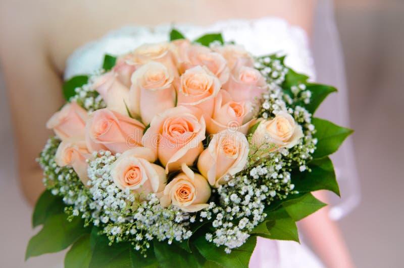 Holding wedding flower stock photo