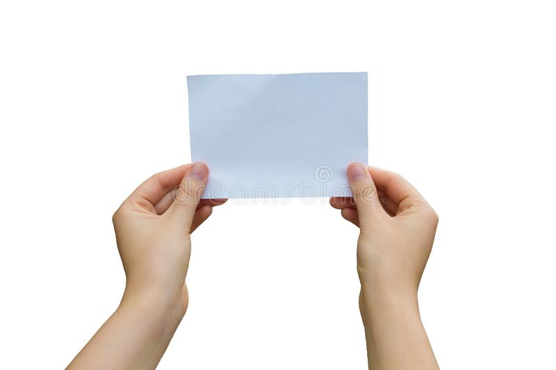 Holding white sheet. Woman hands holding a white paper sheet isolated over white background stock image