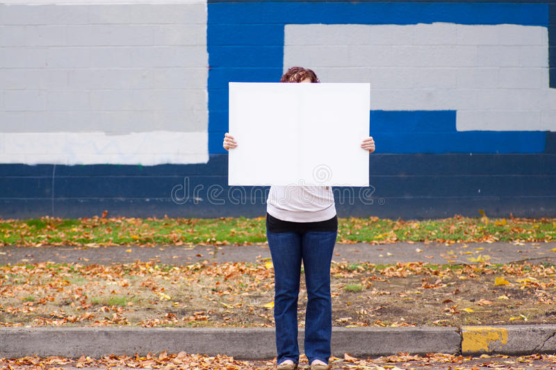 Holding White Sign royalty free stock photos