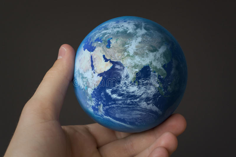 Holding the world stock images