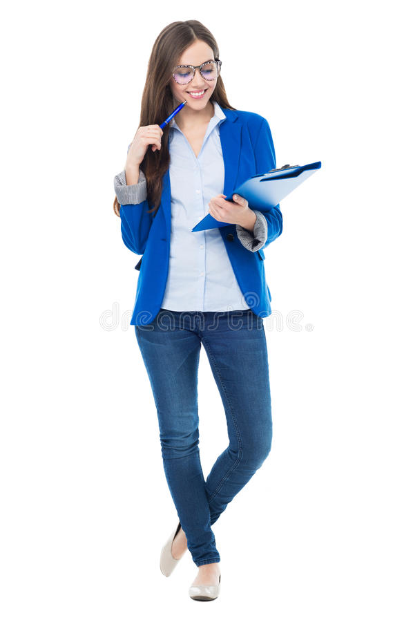 Holdingbücher des weiblichen Kursteilnehmers lizenzfreies stockfoto
