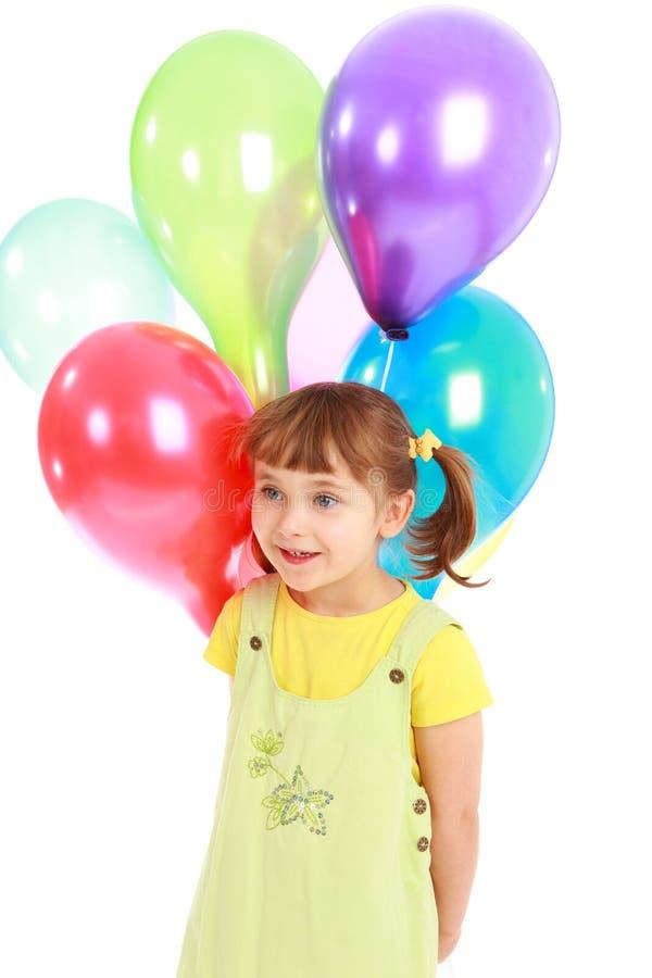 Holdingballone des kleinen Mädchens stockbilder