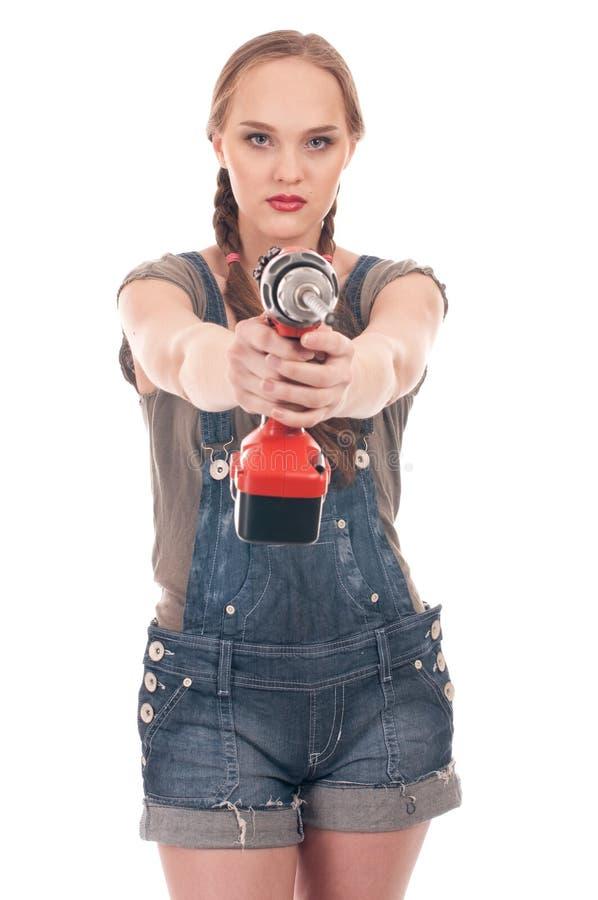 Holdingbohrgerät der jungen Frau mit Schneckenwelle lizenzfreie stockfotografie
