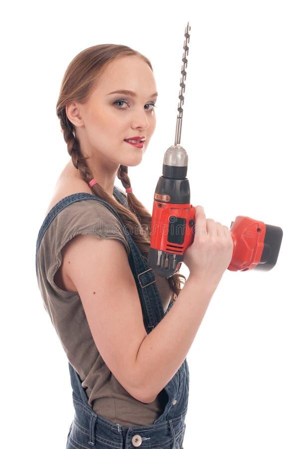 Holdingbohrgerät der jungen Frau mit Schneckenwelle stockbild