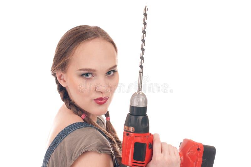 Holdingbohrgerät der jungen Frau mit Schneckenwelle lizenzfreies stockbild