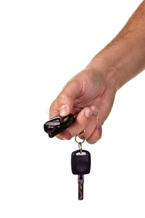 holdingen för bilcontrohanden keys remoten arkivfoto