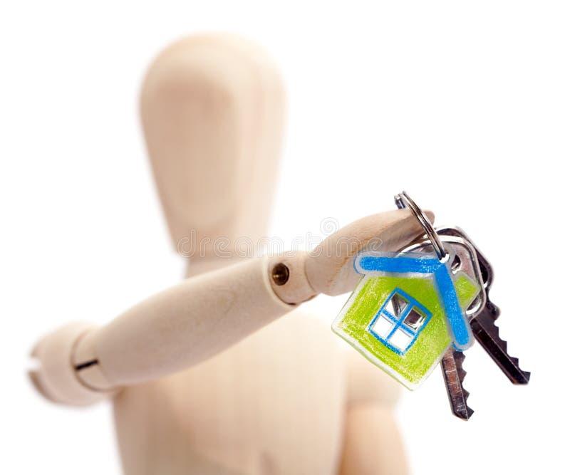 holdingen keys den träskyltdockan royaltyfria foton