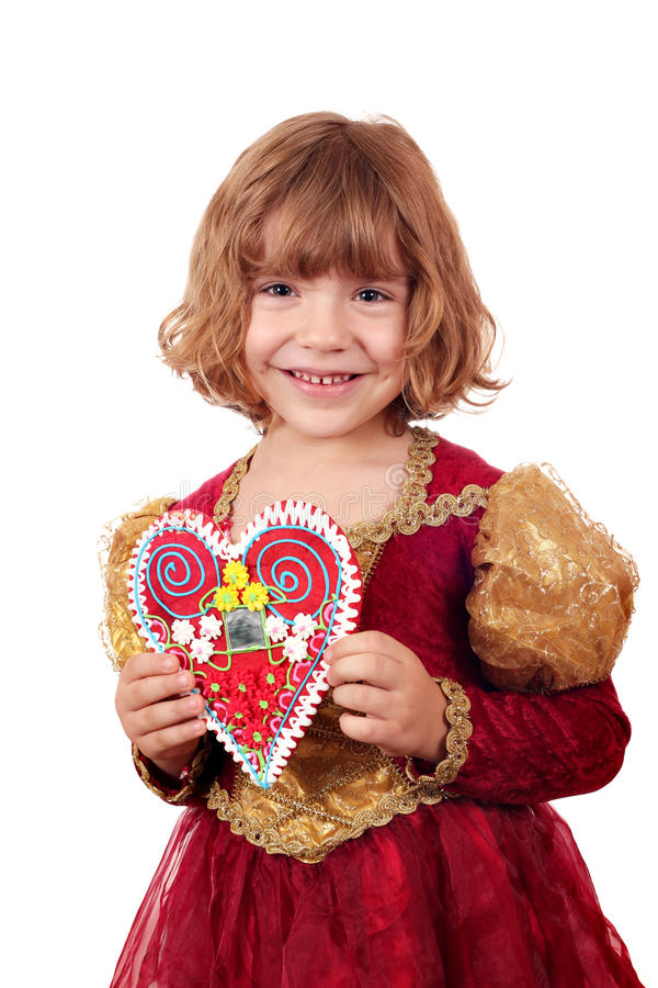 Holdinglebkucheninneres des kleinen Mädchens stockfoto