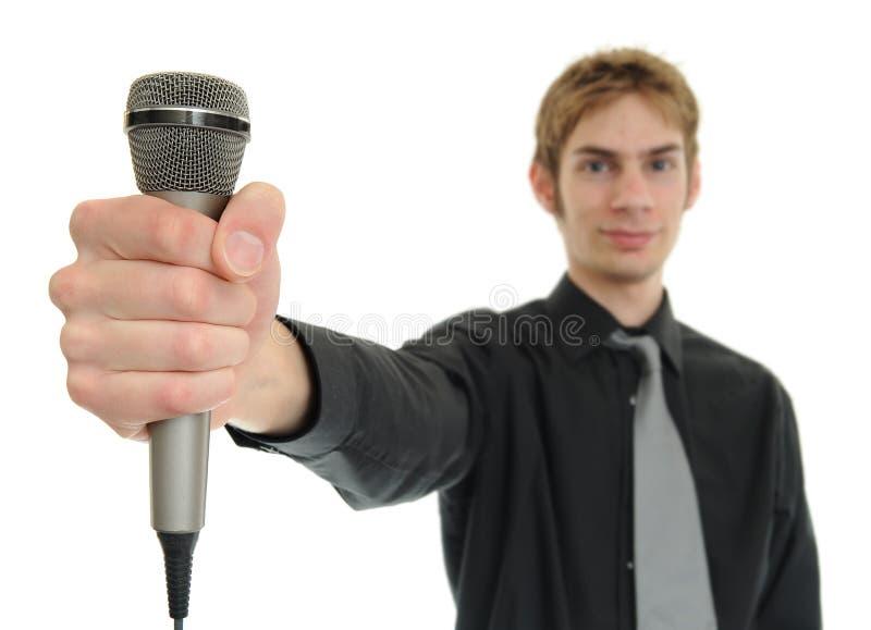 holdingmanmikrofon arkivbilder