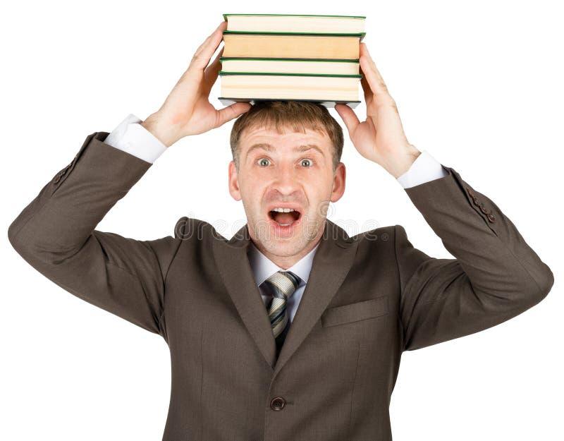 Holdingstapel des jungen Mannes Bücher stockfoto