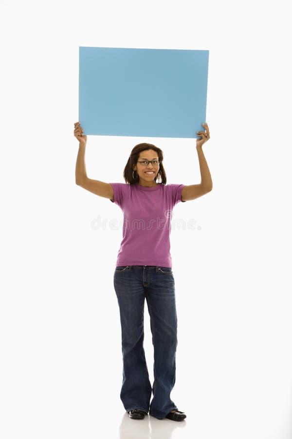 holdingteckenkvinna arkivfoto