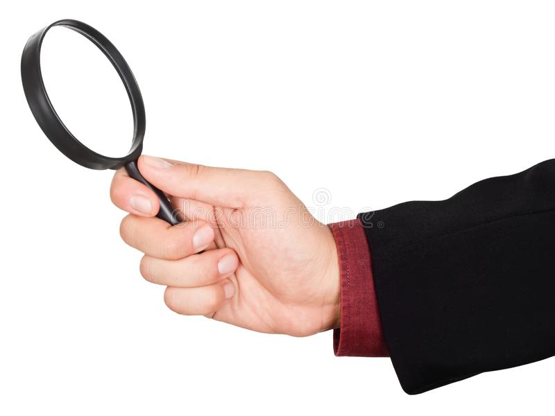 Holdingvergrößerungsglas des Geschäftsmannes Hand stockfotografie