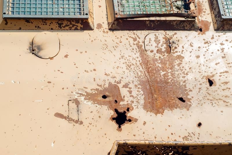Hole from anti-tank missile in armor of armored vehicle royalty free stock image