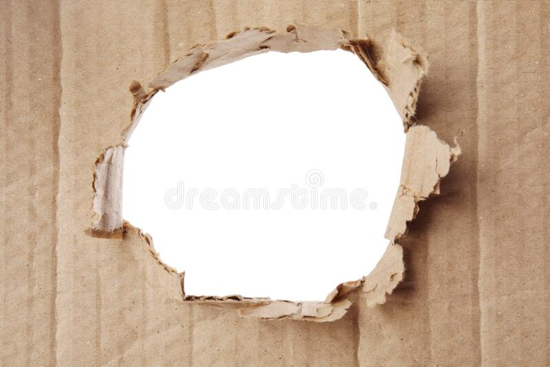 Hole in brown cardboard on background. Hole in brown cardboard on white background stock photography