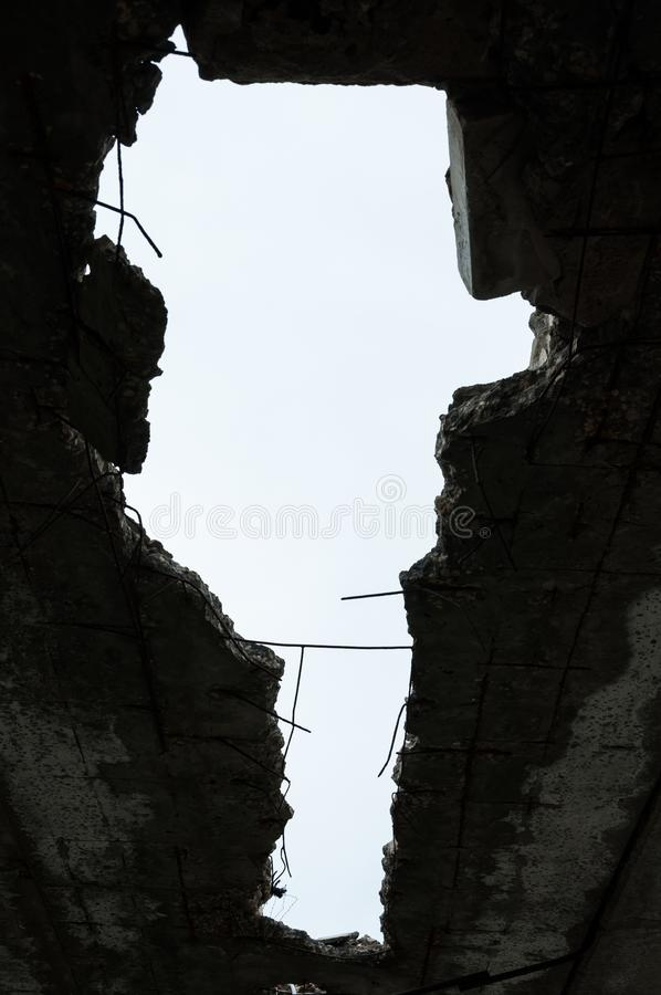 Hole in the ceiling.Destroyed building. Aftermath of the war royalty free stock images
