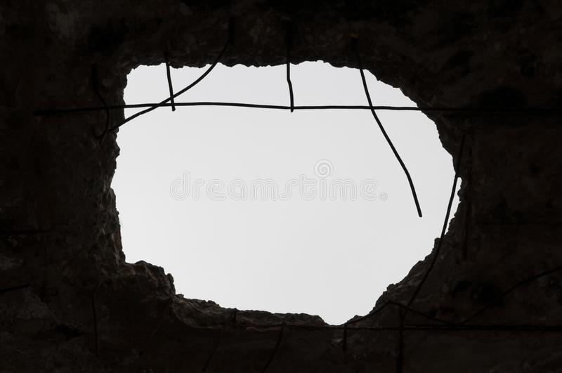 Hole in the ceiling.Destroyed building. Aftermath of the war royalty free stock photo
