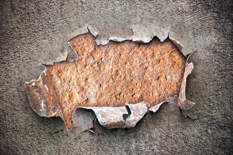 Hole on chipped paint with rusty metal texture. Hole on peeling paint with rusty metal texture ; abstract grunge background royalty free stock photo