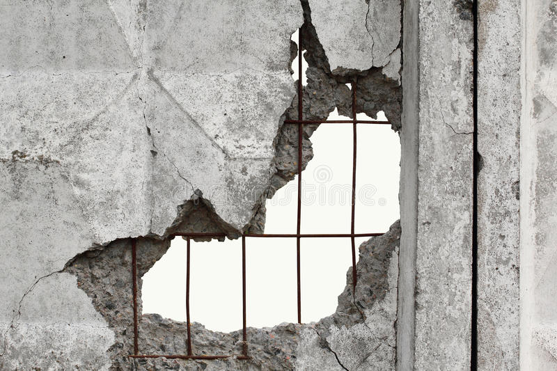White isolated background through hole in a concrete wall royalty free stock image