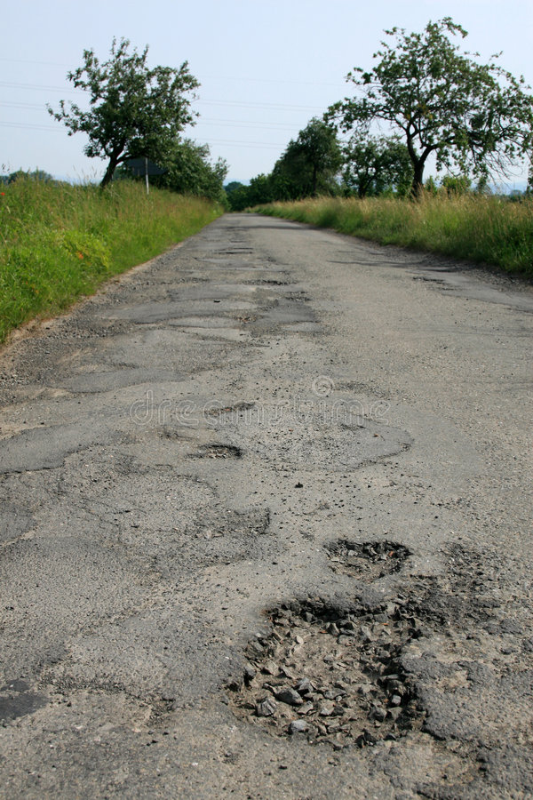 Hole on Damage Road stock photo