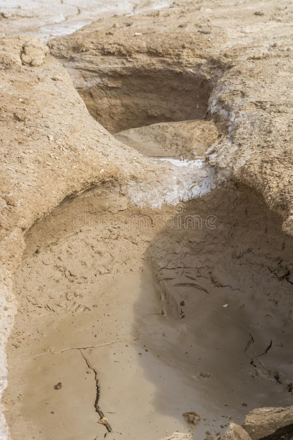 Hole on desert and dry terrain. With mud pattern royalty free stock photo