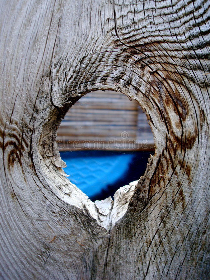 Hole in the fence royalty free stock photo