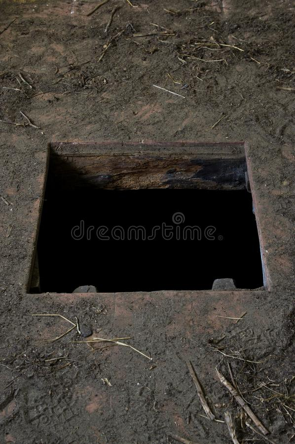 Hole in floor of old house leading to cellar royalty free stock images