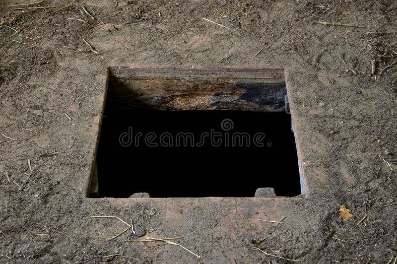 Hole in floor of old house leading to cellar stock photos