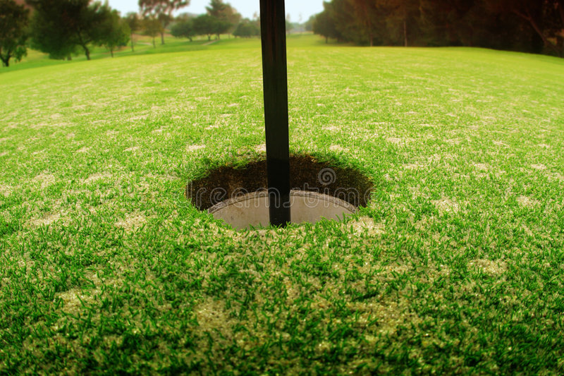 Hole in golf course stock image
