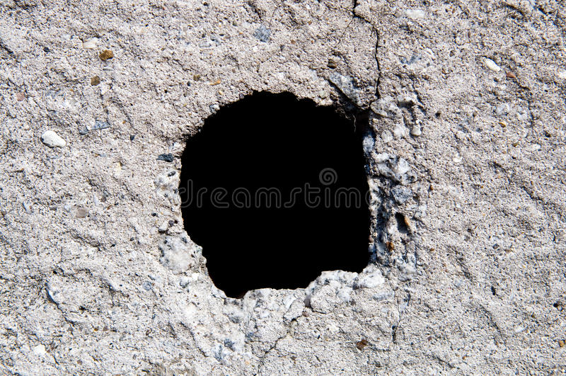 Hole in old wall stock photography
