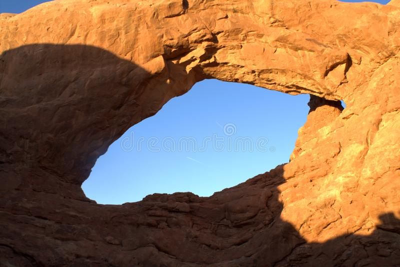Hole in the orange rock stock photography
