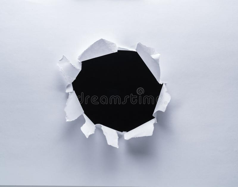 Hole on a paper. Black background in the hole.  stock images