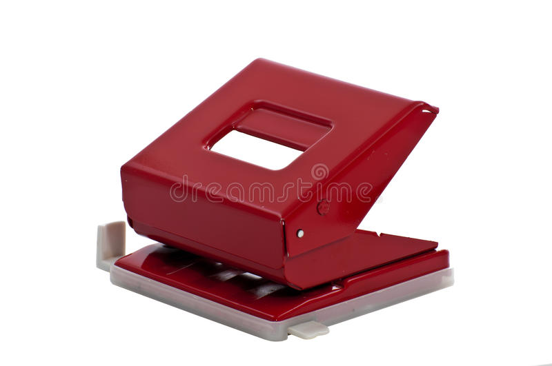 Hole Punch. A red hole punch on white background stock images