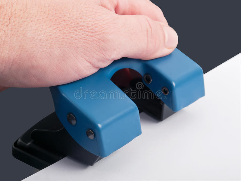 Hole punch. Drilling hole punch with paper, studio shot royalty free stock image