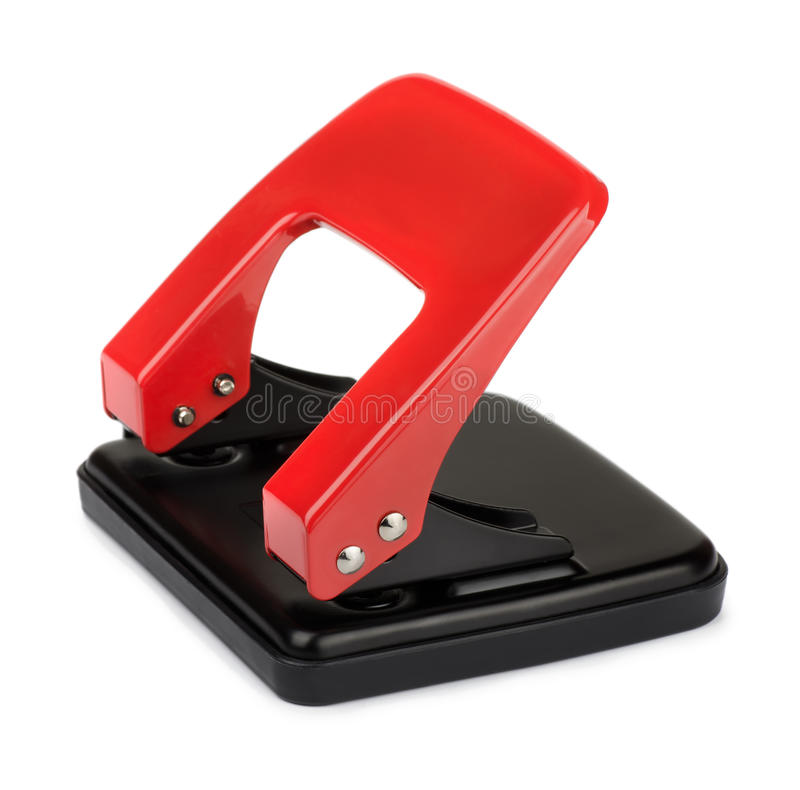 Hole puncher. Red office hole puncher isolated on white stock photos