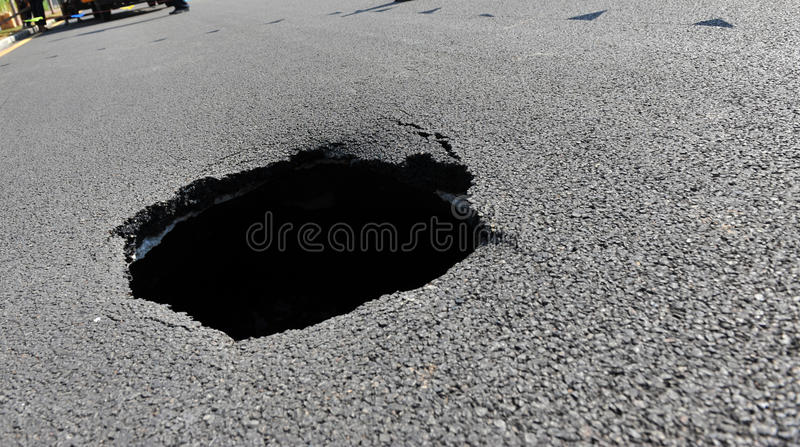 Hole in the road. Dangerous hole in the road royalty free stock images
