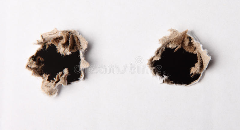 hole in white paper stock images
