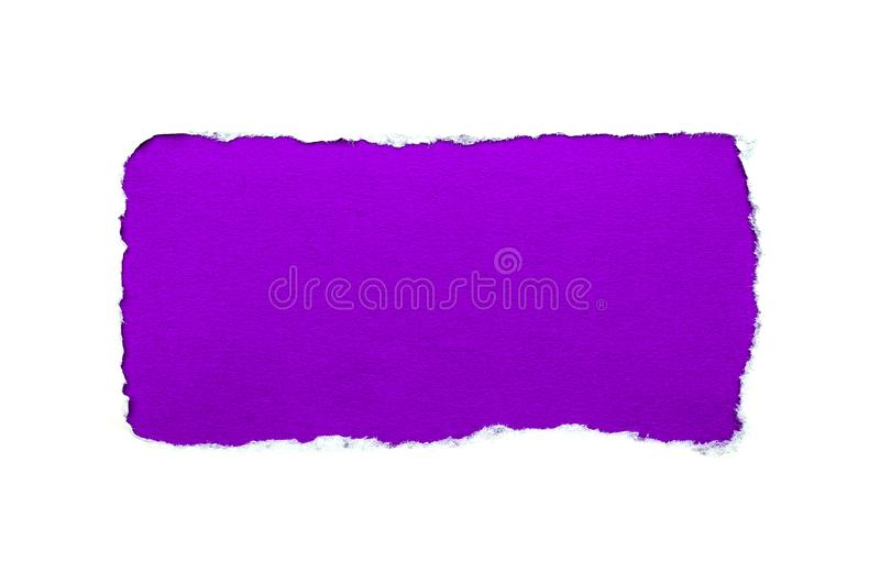 A hole in white paper with torn edges isolated on a white background with a bright violet color paper background inside. Good stock photos