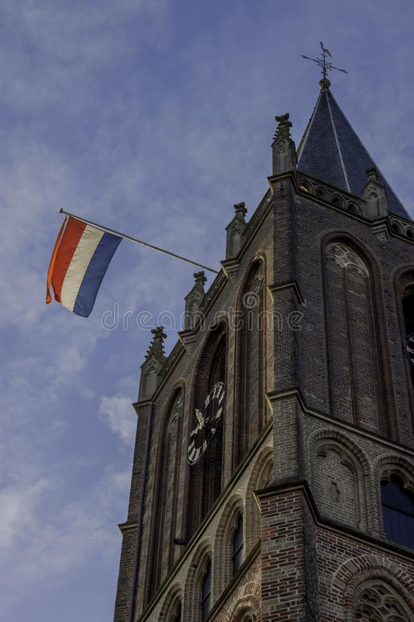 Holender flaga na kościół na wyzwolenie dniu w Holandia obrazy stock