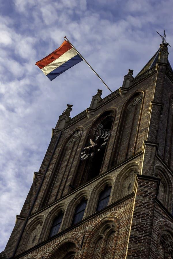 Holender flaga na kościół podczas wyzwolenie dnia Holandia zdjęcie royalty free