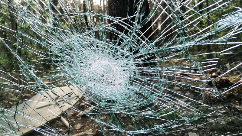 Holes and cracks on the glass On defocused background. Close up royalty free stock photo